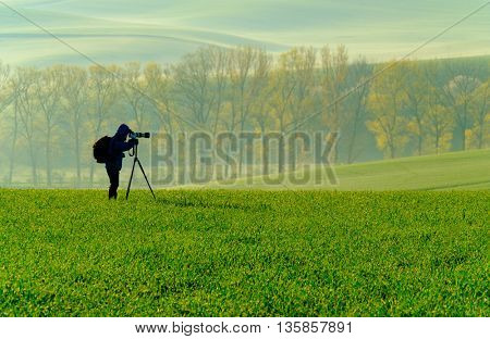 Nature photographer takes landscape picture