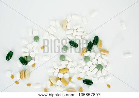 Pills Scattered On White Background