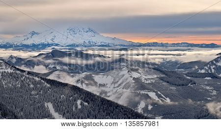 The Snowy Peak of Mount Rainier Towering Above the Clouds. Granite Mountain, Snoqualmie Pass, Washington.