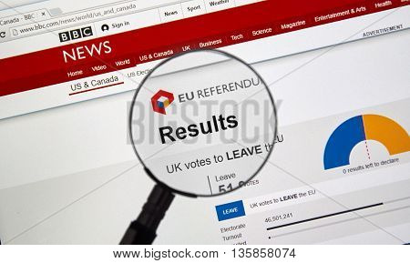 MONTREAL CANADA - JUNE 24 2016 : Brexit results on BBC news site under magnifying glass. The Brexit an abbreviation of 'British exit' refers to the possibility of Britain's withdrawal from the EU