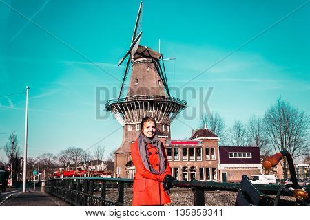 Girl In Front Of A Windmill In Amsterdam, Netherlands