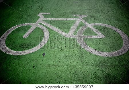 Bicycle paint on green route for bikes