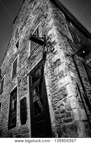 Old stone house facade in Old Montreal in black and white