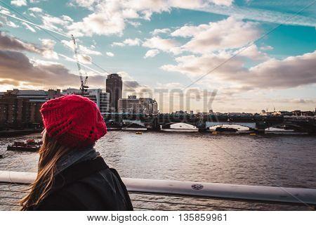 Photo of Girl crossing Millennium Bridge in London