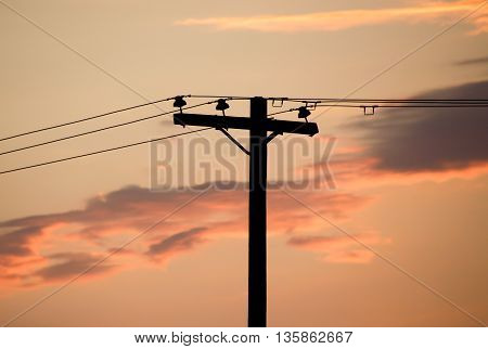Electricity Pole And Cloudy Sky