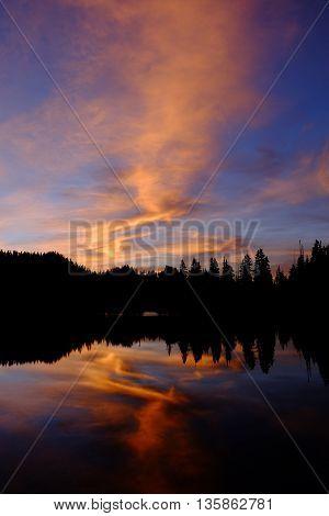 Orange and Blue Sunset and Trees Reflected in Alpine Lake. Olympic National Park, Washington