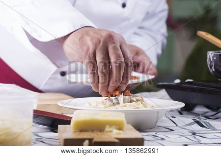 Chef decorated Spaghetti carbonara with cryspy bacon / cooking spaghetti concept
