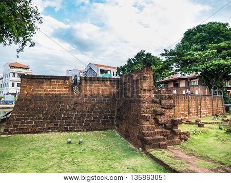 Old stone fortifications of Malacca beside the river in Malacca Malaysia
