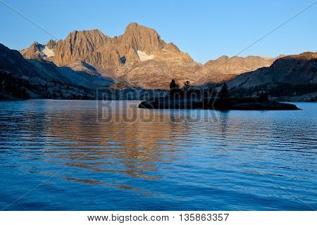 Sunrise Illuminates Mt Ritter and Banner Peak Over Garnett Lake. The Ansel Adams Wilderness, Sierra Nevada, California