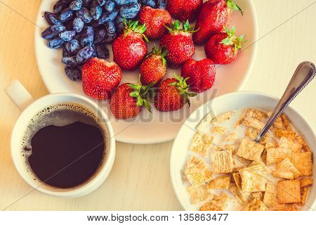 Healthy Breakfast. Corn Flakes With Ripe Red Strawberry, Blue Honeysuckle Berries And Cup Of Coffee