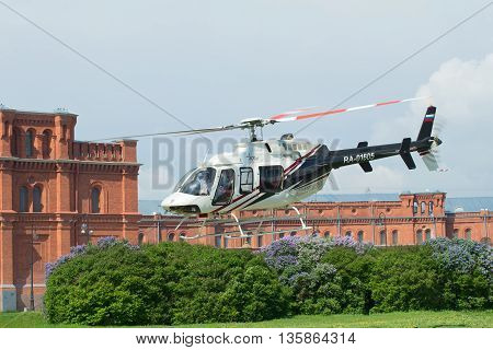 SAINT PETERSBURG, RUSSIA - MAY 22, 2016: The take-off of a private helicopter Bell 407GX (RA-01605) from the helicopter pad at the Peter and Paul fortress