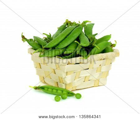 green pea pod green peas. Fresh pods of green peas in the basket isolated on white background. Summer. Vitamins Diet.