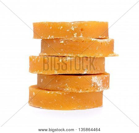 Sugarcane Hard Molasses or Jaggery isolated on a white background