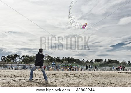 Cervia, Italy - April 30, 2016: Man manages kite during a kite festival