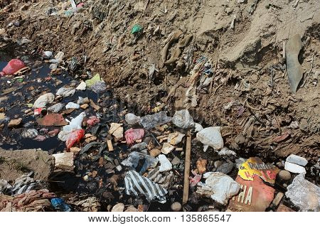 BALI, INDONESIA - APRIL 30: Toxic household garbage, plastic bags and hazardous industrial waste contaminates soil and water at a polluted landfill site on April 30, 2016 in Bali, Indonesia.