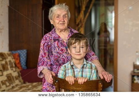 Grandmother and grandson posing for the camera.
