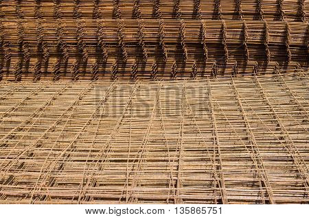 Steel mesh hole in close-up. Screw thread steel bar framework in the construction site.