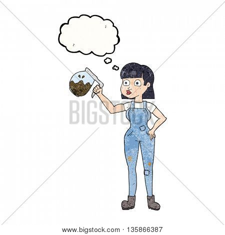 freehand drawn thought bubble textured cartoon woman in dungarees with coffee