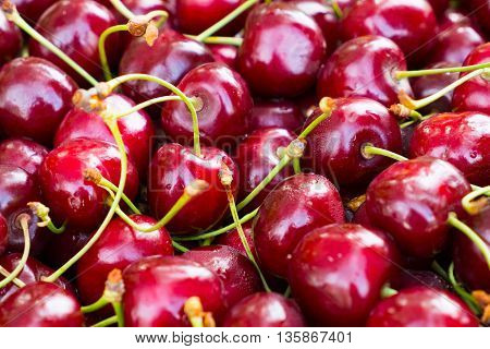 Large red cherry. Background of berries of cherry. Beneficial dietary food. The gifts of nature vitamin. Delicious berries cherries with water droplets.