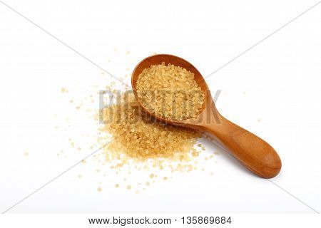 Scoop Of Brown Cane Sugar Isolated On White