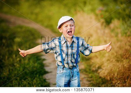 Stylish little boy in a rural location