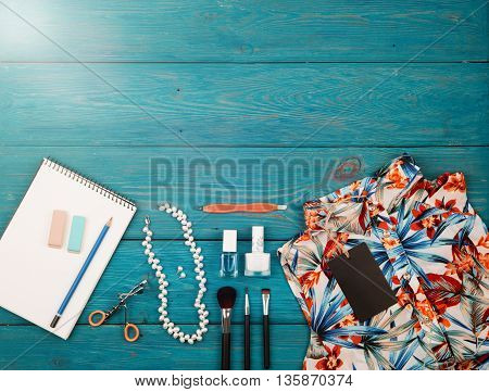 Sale Concept - Set Of Woman Stuff On Blue Wooden Background; Essentials; Accessories