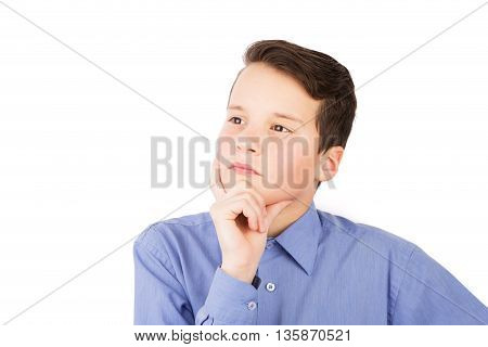 Portrait Of The Young Teen Boy. He Is Standing And Looking Pensively And Think. His Hand At The Chin