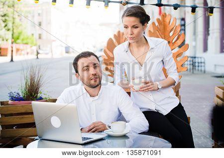 Man and Woman at outdoors Bar. Short Depth of Focus.