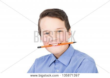 Smiling Schoolboy In A Shirt With A Pencil In His Mouth Isolated On White Background