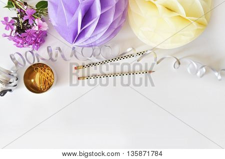 Colorful balls, party and glamour style, gold accessories. White background. yellow., gold, mint, table view woman
