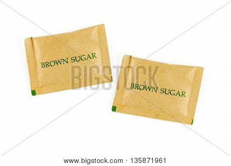 close up brown sugar sachet isolated on white background.