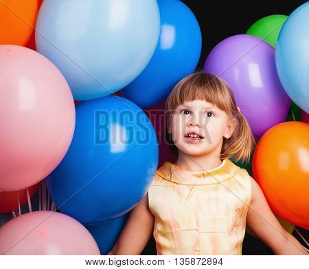 Caucasian Blond Little Girl With Colorful Balloons