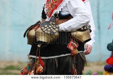 Pernik, Bulgaria - January 30, 2010: Unidentified man in traditional Kukeri costume are seen at the Festival of the Masquerade Games Surva in Pernik, Bulgaria.