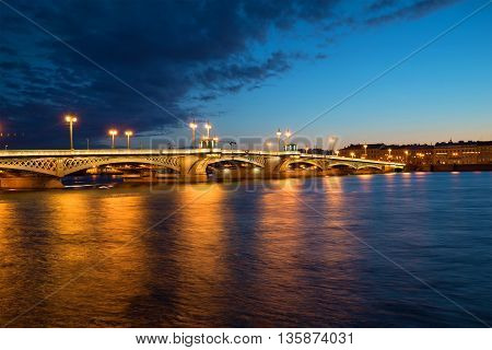 SAINT PETERSBURG, RUSSIA - JULY 06, 2015: Annunciation bridge white july night. Historical landmark of the city Saint Petersburg