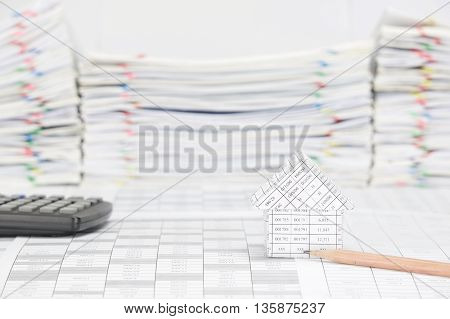 House With Pencil Have Blur Calculator And Paperwork As Background