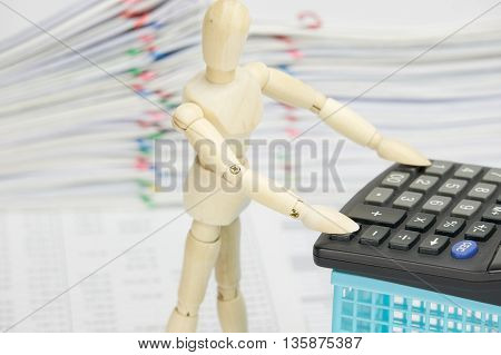 Wooden Dummy Using Calculator On Finance Account