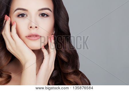 Beautiful Woman. Cute Face. Healthy Hair and Clear Skin. Girl Touches her Skin