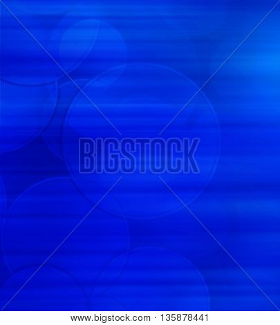 Abstract circles on blue background blur holiday card.