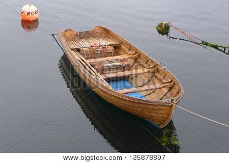 Wood boat on the fjord in Norway