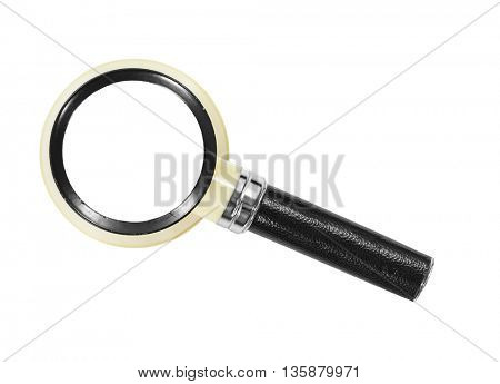 Vintage magnifying glass isolated on white.