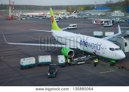 MOSCOW, RUSSIA - APRIL 30, 2016: Loading luggage into the airplane Boeing 737 Next Gen (VQ-BKW ) airlines S7 Siberia Airlines at Domodedovo airport