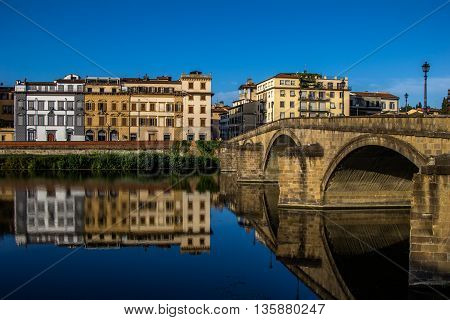 River Arno embankment mirror reflections, Florence (Italy)