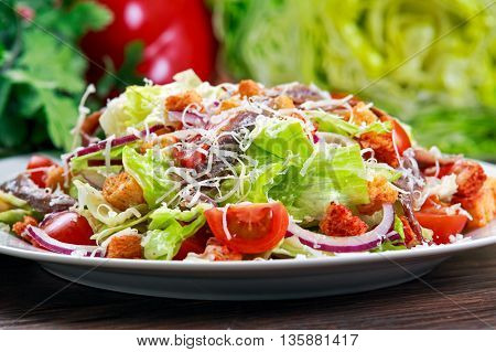 Fresh healthy Classic Caesar salad with anchovies and parmesan. selected focus