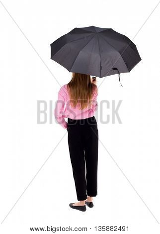 young woman under an umbrella. Rear view people collection.  backside view of person.  Isolated over white background. Woman office worker in a pink shirt standing under an umbrella.