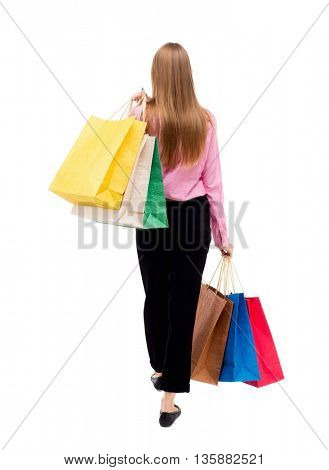 back view going woman with shopping bags. beautiful girl in motion. backside view person. Rear view people collection. Isolated over white background woman in pink shirt went off throwing shoulder bag