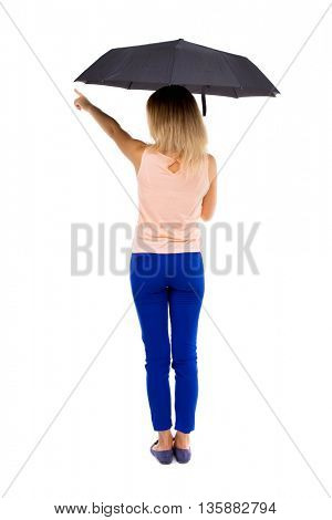 pointing  woman  under an umbrella. Rear view people collection.  backside view of person.  Isolated over white background. The girl under an umbrella stands and shows the right hand.