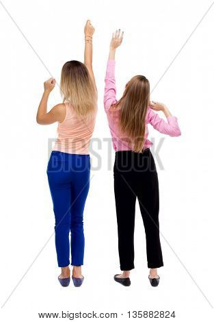 Back view of two young  women dancing.  Rear view people collection.  backside view of person.  Isolated over white background. Two blonde girls dancing waving his arms.