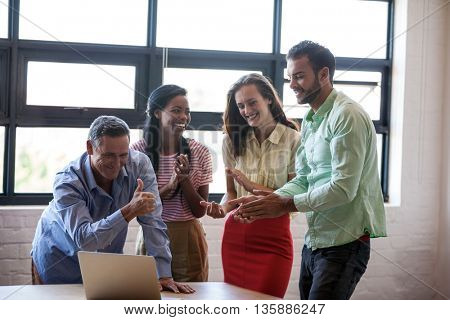 Portrait of business team laughing in agency