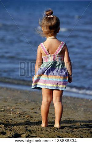 Small girl on the beach in Larnaka Cyprus