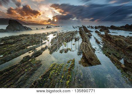 Cloudy sunset at Sakoneta beach, in Deba